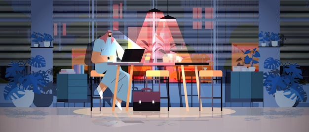 Overworked arab businessman sitting at workplace business man freelancer looking in computer screen dark night home office horizontal full length vector illustration