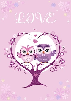 Owls couple in love sitting on a tree branch.