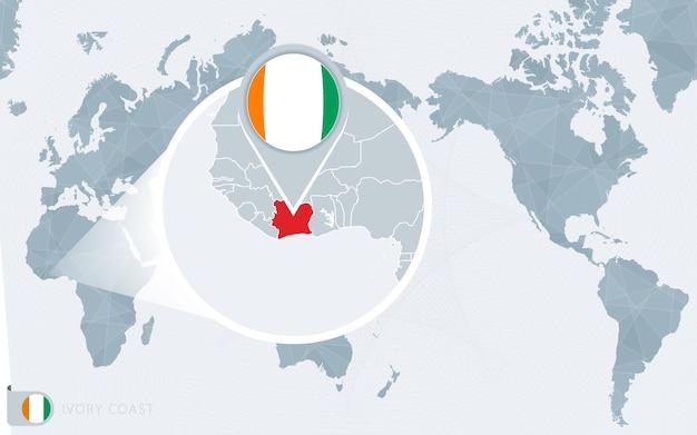 아이보리 코스트가 확대된 태평양 중심의 세계 지도. 코트디부아르의 국기와 지도.