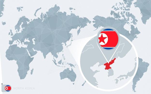 확대된 북한이 있는 태평양 중심 세계 지도. 북한의 국기와 지도.