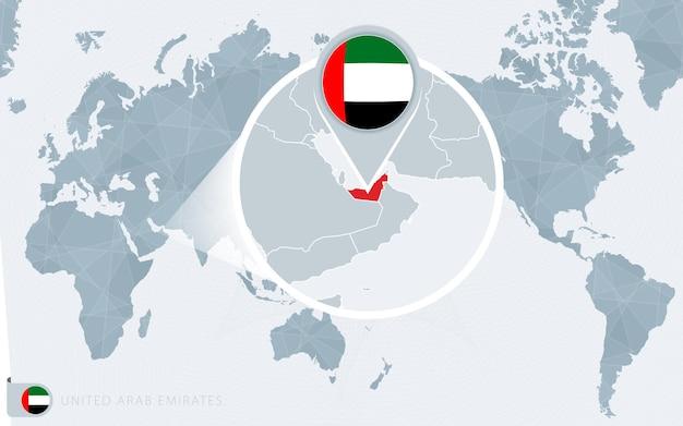 アラブ首長国連邦の旗とアラブ首長国連邦の地図が拡大された太平洋中心の世界地図