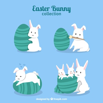 Pack of bunnies with easter eggs