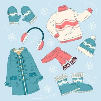 Confezione di abiti invernali accoglienti disegnati ed essenziali