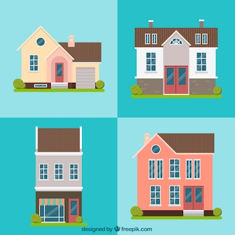 Pack of four beautiful houses facades in flat design
