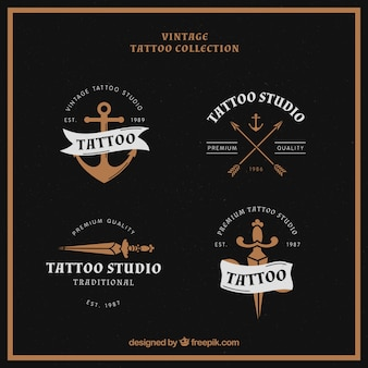 Pack of four tattoo logos in vintage style
