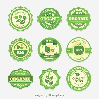 Pack of nine round organic food stickers Free Vector