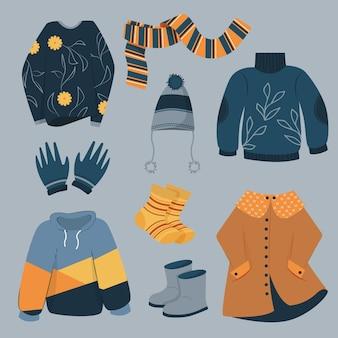 평평한 겨울 옷과 필수품 팩