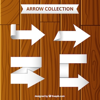 Pack of four white arrows with geometric shapes