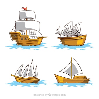 白い帆の4つの木製ボートのパック