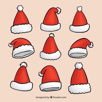 手のパックは、サンタクロースの帽子を描いた