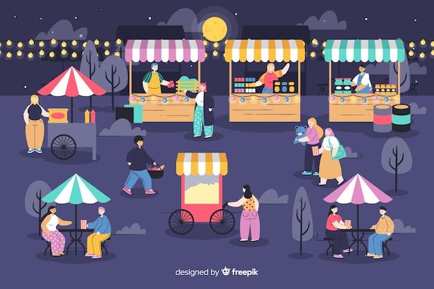 Стая людей на ночной ярмарке