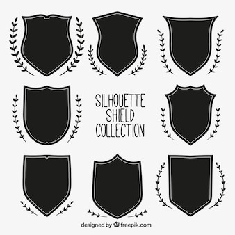 Pack of shields silhouettes with natural ornaments