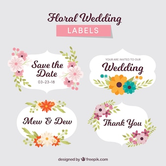 Pack of wedding badges with flowers