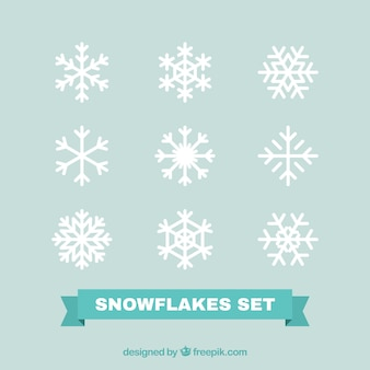 Pack of white decorative snowflakes in flat design