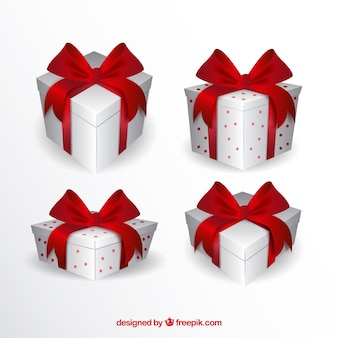 Pack of white gift boxes with red ribbons