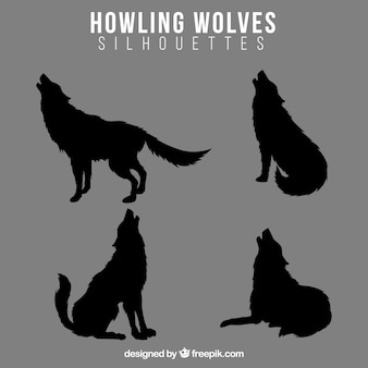 Pack of wolf howling silhouettes