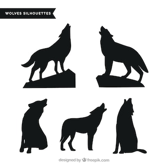 Pack of wolves howling silhouettes