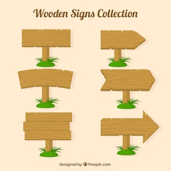 Pack of wood signs with grass