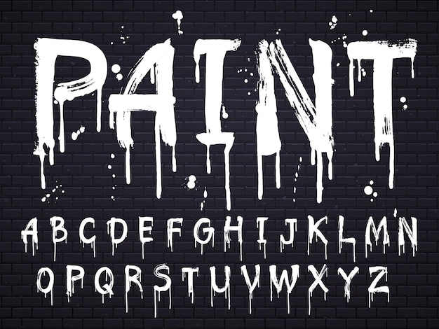 Paint dripping paint font for latin alphabet isolated on black brick wall