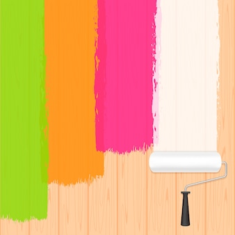 Paint roller colors on wooden wall background and copy space text advertising