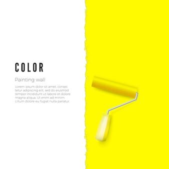 黄色のペンキと垂直壁のテキストまたはその他のスペースでペイントローラー。図