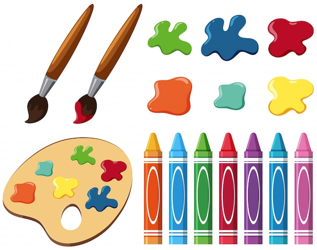 Paintbrushes and crayons on white background
