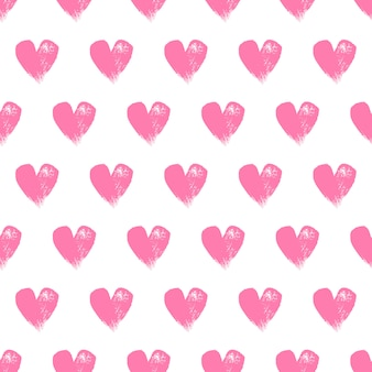Painted pink hearts on white seamless pattern.