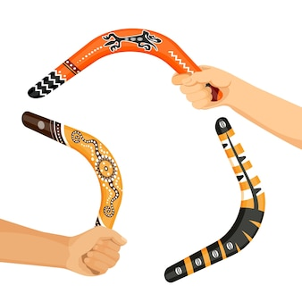 Painted traditional australian boomerang tools in hands vector illustration isolated on white background. ornamental aboriginal weapons
