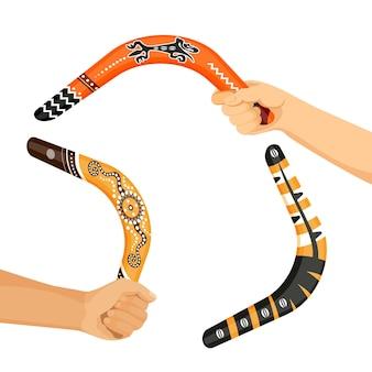 흰색 배경에 고립 된 손 벡터 일러스트 레이 션에 전통적인 호주 부메랑 도구를 그렸습니다. 장식용 원주민 무기