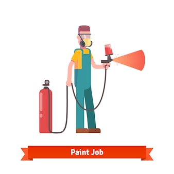 Painting specialist spraying paint from pulveriser