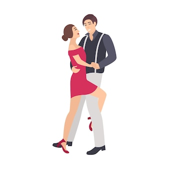 Pair of elegantly dressed boy and girl dancing salsa