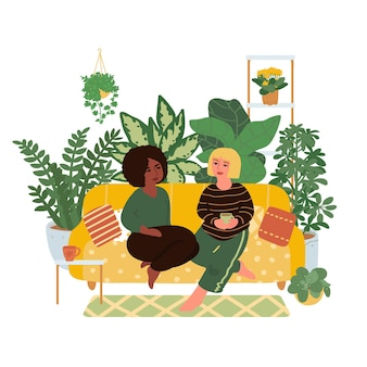 A pair of girls sitting on the couch. multinational couple. hand draw. vector illustration in flat style isolated on white background.