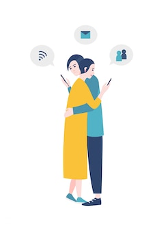 Pair of man and woman standing, hugging and checking social media accounts on their smartphones