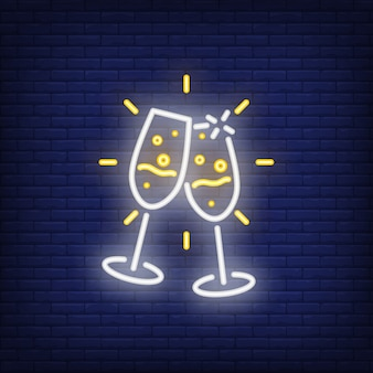 Pair of neon champagne flutes. night bright advertisement element.