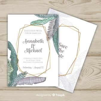Palm leaves in pastel colors wedding invitation template