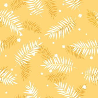 Palm leaves pattern in yellow color in flat style for summer background and textile