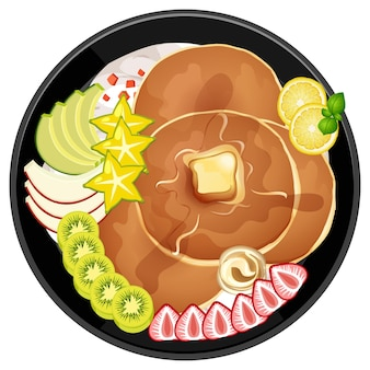 Pancake with kiwi and strawberry toppings in a plate isolated