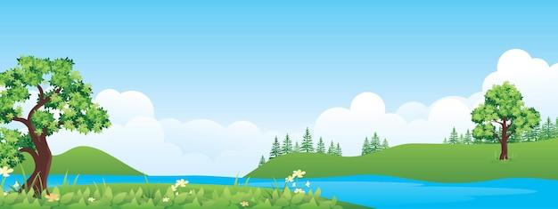 湖と丘のあるパノラマの美しい田園風景