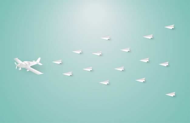 Paper airplane among white origami airplanes