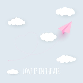 Paper airplane heart background. love is in the air concept.