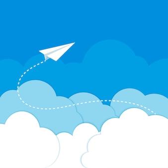 青色の背景に雲の中の紙飛行機