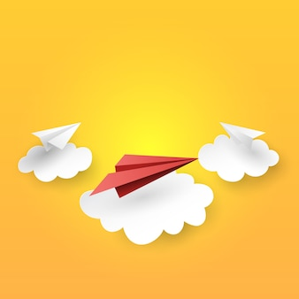 Paper airplanes flying on clouds background