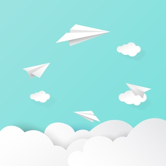 Paper airplanes flying on clouds and sky background
