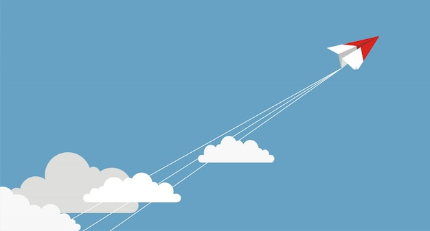 Paper airplanes flying from clouds on blue sky
