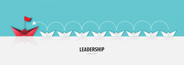 Paper art of leadership concept with origami boat in river background