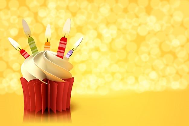 노란색 배경에 케이크 컵의 종이 예술