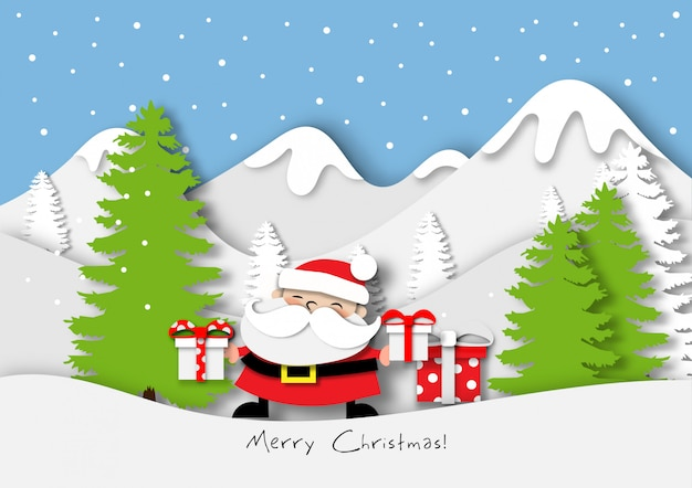 Paper art of santa claus with gift box in the snow mountain background