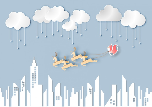 Paper art of santa claus with reindeer on blue sky and city background