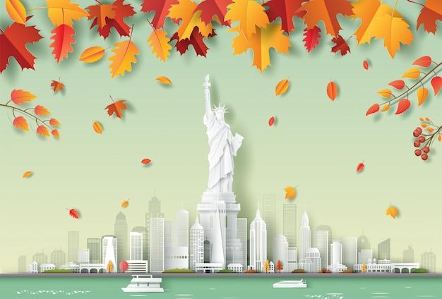 Бумажный художественный стиль статуи свободы, горизонт города нью-йорк сша, красивый пейзажный осенний фон, концепция путешествий и туризма.