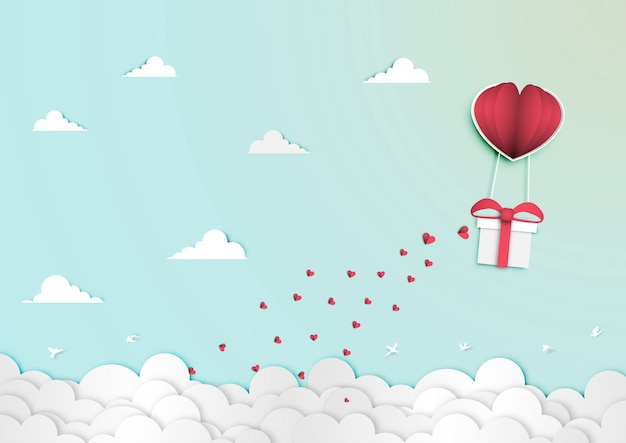 Paper art of valentine day festival with gift box in paper balloon heart shape vector